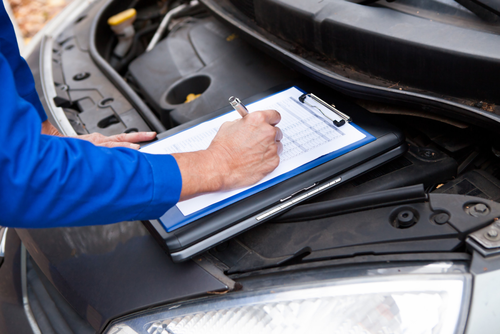 Mechanic Maintaining Car Records